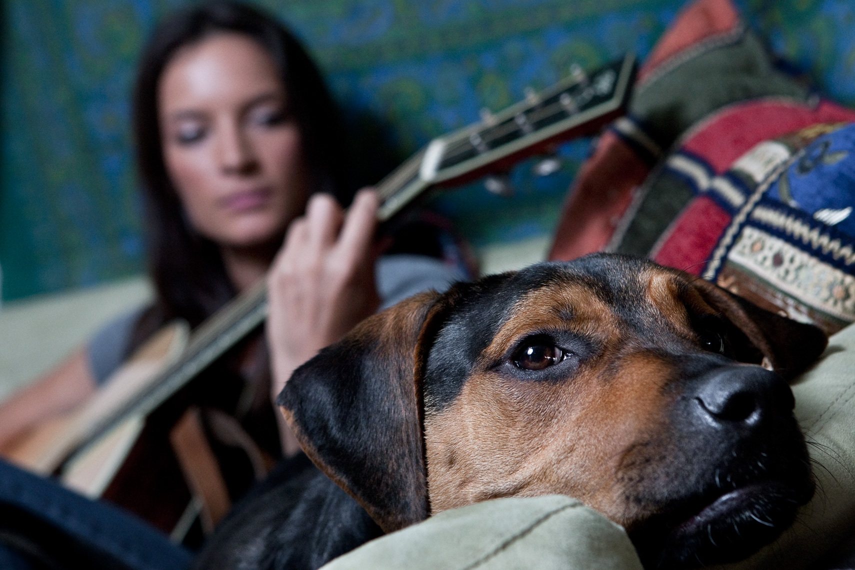 Los Angeles Dog Photography, Michael Brian, Girl playing guitar on couch with dog