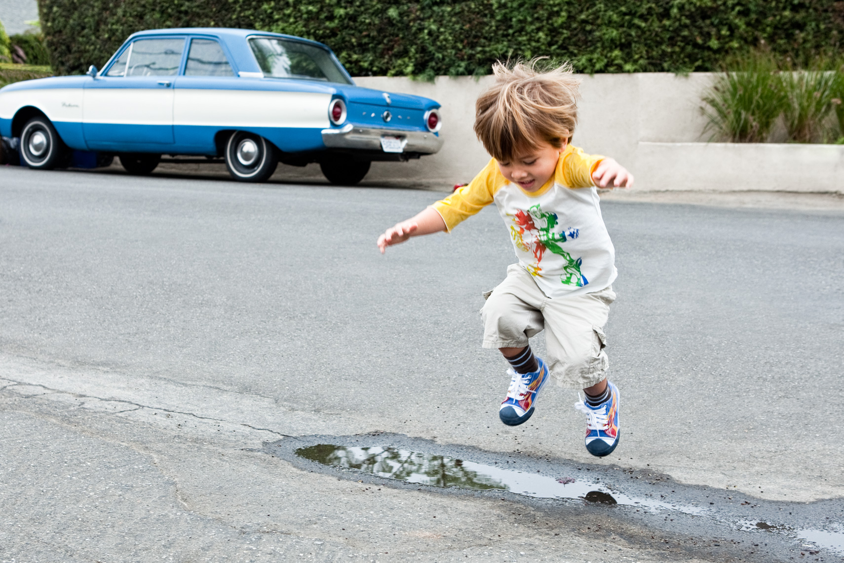 Los Angeles portrait Photography, Michael Brian, dog, pet, cat, children, lifestyle, Young boy jumps over puddle