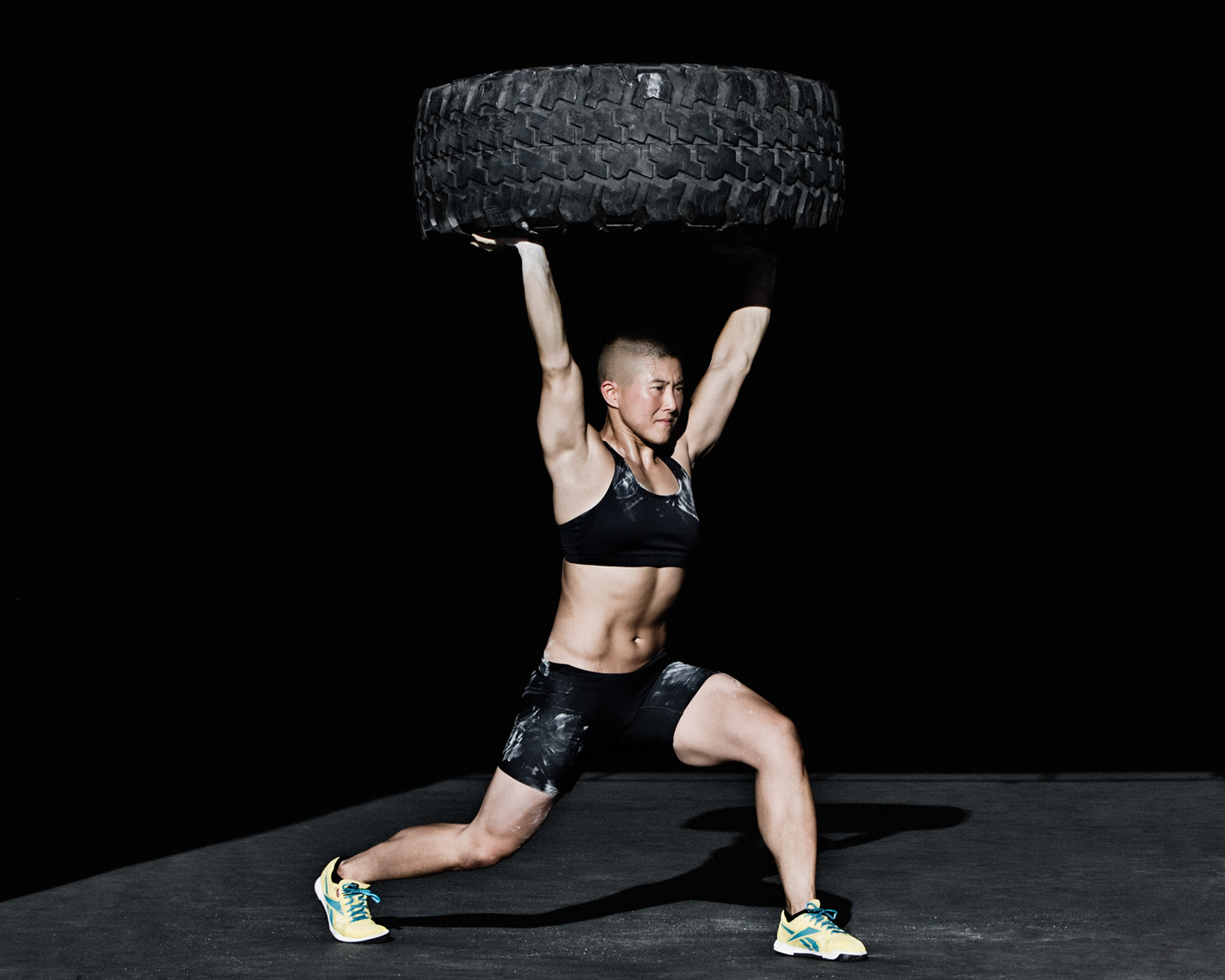 Los Angeles Sports Photography, Michael Brian, athlete, female, Kristan Clever, walking lunge, tire overhead, Former Crossfit Games Champion, Reebok