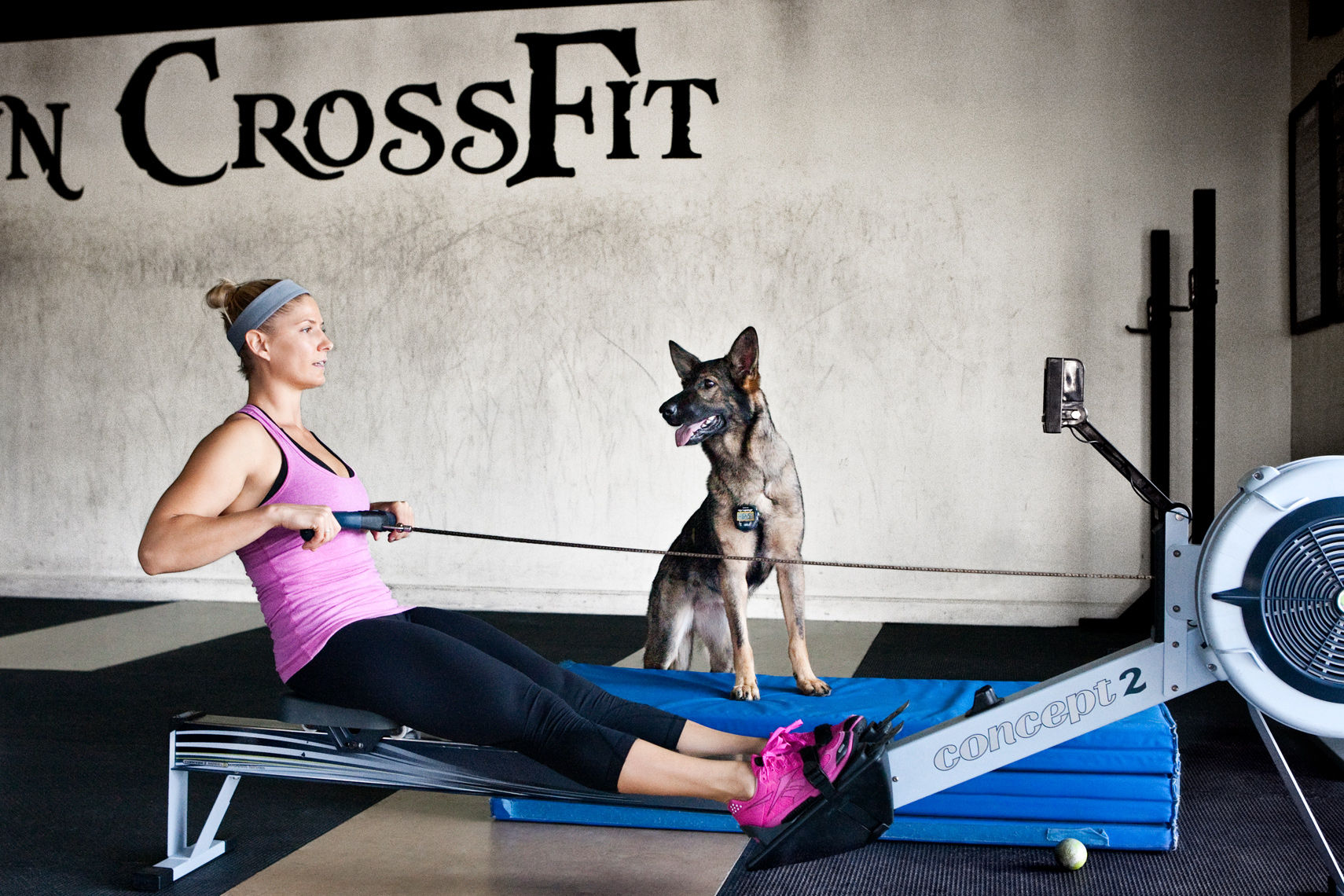 Crossfit, LA Dog Photography, Michael Brian, Los Angeles, Sports, Elizabeth Burns on a Concept 2 rowing machine with a German Shepherd at Dogtown Crossfit