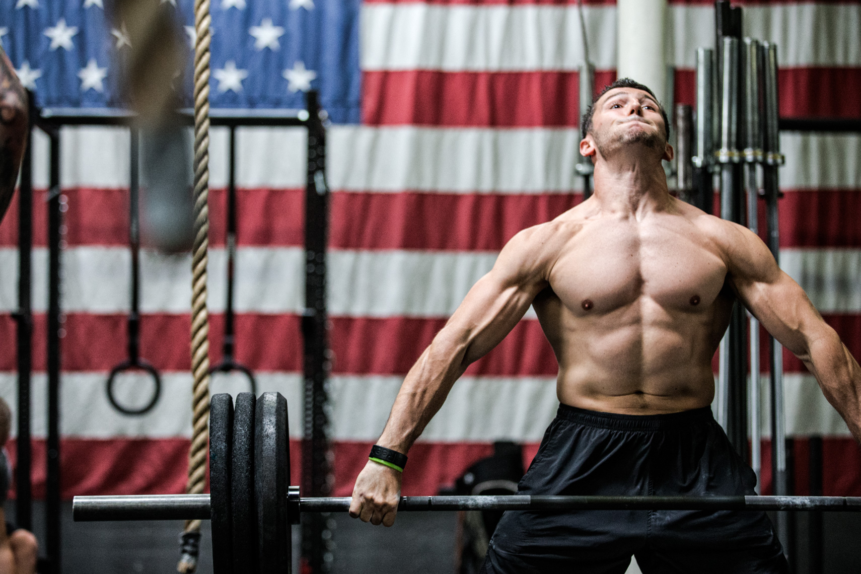 Los Angeles Sports Photography, Michael Brian, Austin Malleolo, Crossfit Games athlete, snatching in front of giant American flag, Crossfit One Nation, Reebok, Rogue