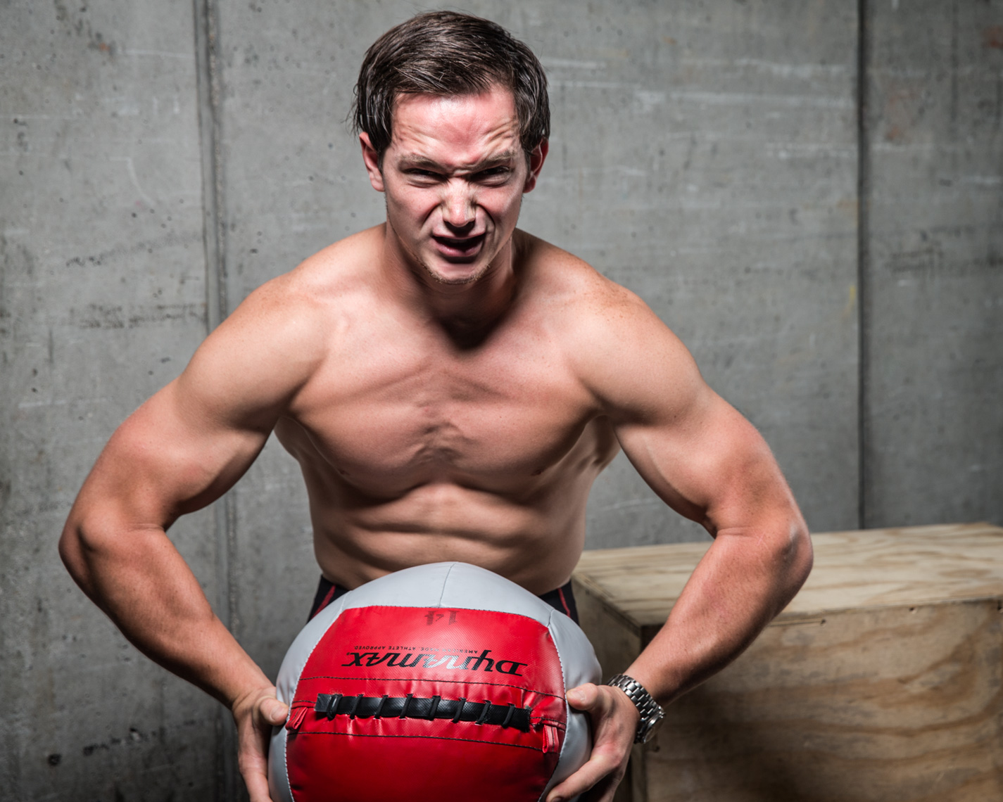 Los Angeles Sports Photography, Michael Brian, athlete, James Hobart flexing, Humorous athlete portrait, Reebok Crossfit Games, smashing wall ball