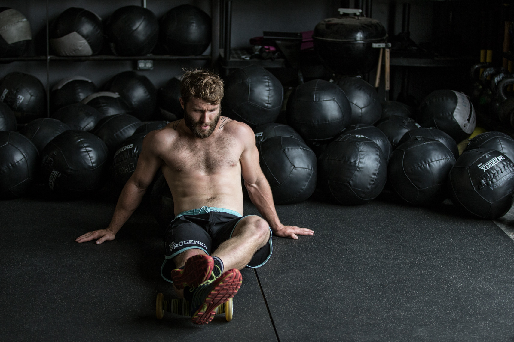 Los Angeles Sports Photography, Michael Brian, Pat Barber, Crossfit, Soulful portrait of Reebok Crossfit Games athlete, sitting against wall balls