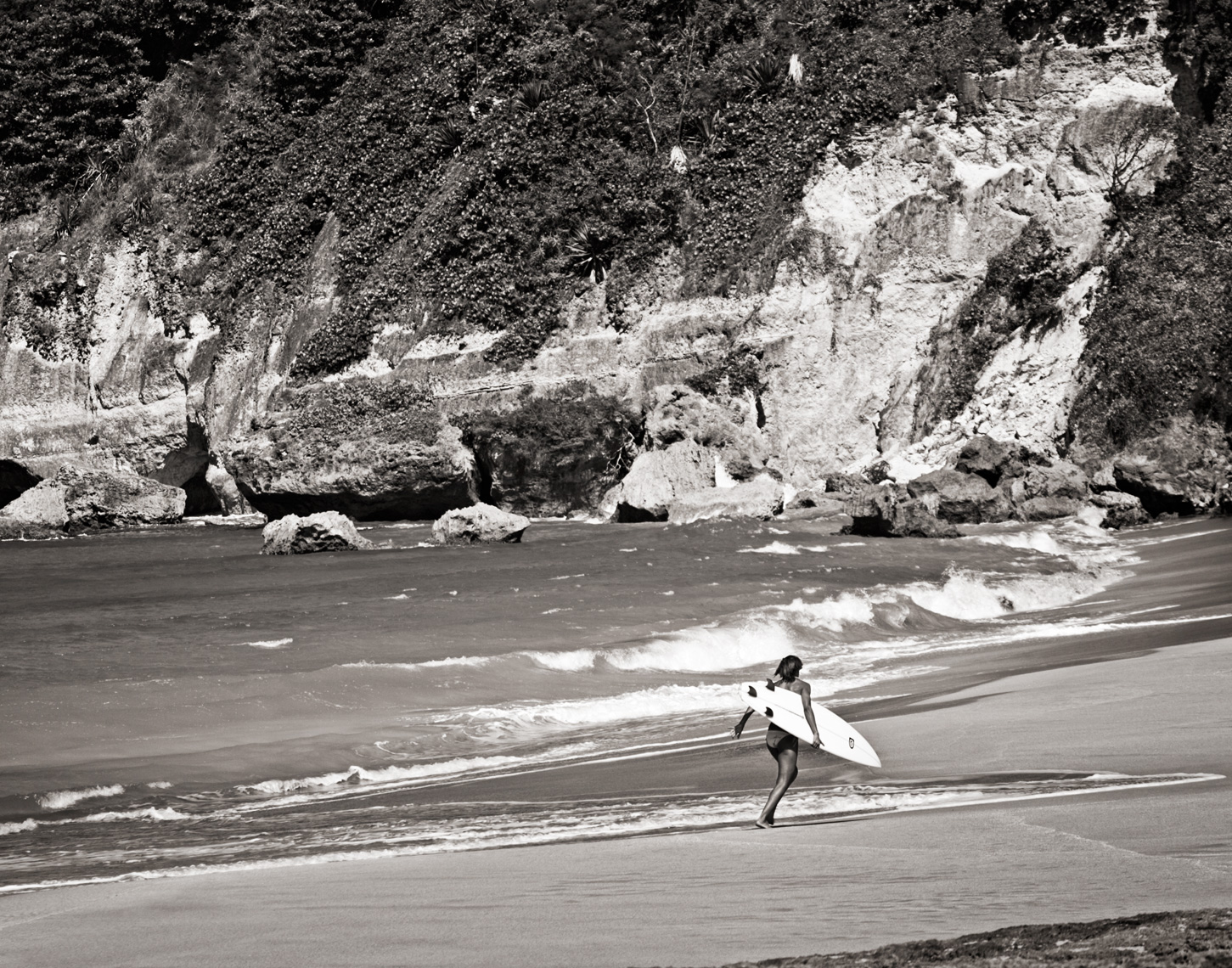 Los Angeles Sports Photography, Michael Brian, dog, pet, cat, lifestyle, Puerto Rican professional surfer Julie Gonzales running on beach in Aguadilla, Puerto Rico